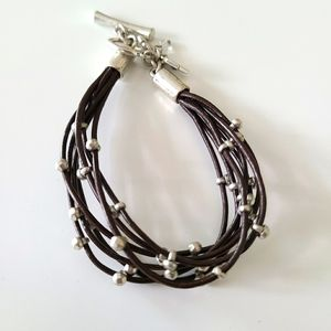 Brown string bracelet with silver beads
